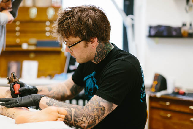 Matthew Gordon at work tattooing